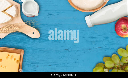 Shavuot background on blue with fruits - Stock Image