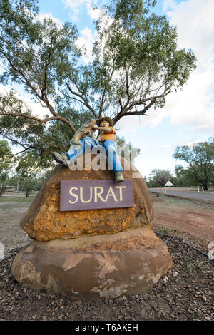Statue of a fisherman on a boulder at the entrance of the small rural town of Surat, Maranoa Region, Queensland, QLD, Australia - Stock Image