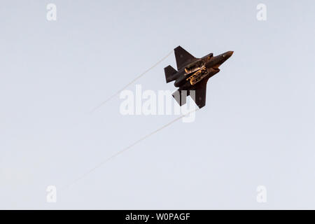 Hazerim Air Base, Israel. 27th June, 2019. A Lockheed Martin F-35 Lightning multi role combat aircraft demonstrates flight capabilities at an air show at a graduation ceremony honoring newly certified Israel Air Force pilots and navigators following their successful completion of one of the most competitive and rigorous training processes in the IDF at Hazerim Air Base in the Negev Desert. Credit: Nir Alon/Alamy Live News. - Stock Image