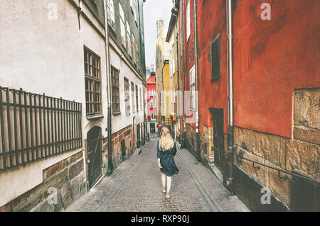 Stockholm city tour woman walking traveling alone lifestyle summer vacations in Sweden old street - Stock Image