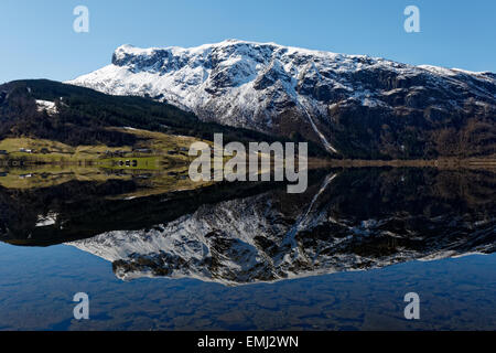Reflection of the mountains meeting the sea at Granvinsvatnet, in Hardanger, Norway. - Stock Image