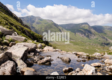 View across mountain stream to Y Garn and northern Glyderau above Ogwen Valley in mountains of Snowdonia National - Stock Image