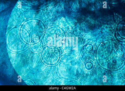 ripples in a blue pool - Stock Image