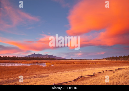 Fiery winter sunset at Marshall Lake with San Francisco Peaks in background, Coconino National Forest, near Flagstaff, - Stock Image