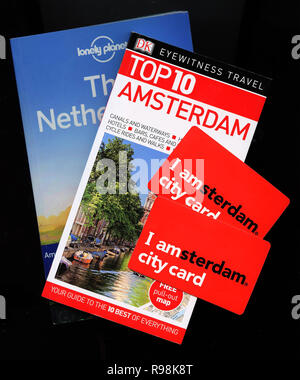 Lonely Planet, Eyewitness Travel Top 10 for Amsterdam, Holland, Netherlands together with I amsterdam cards - Stock Image