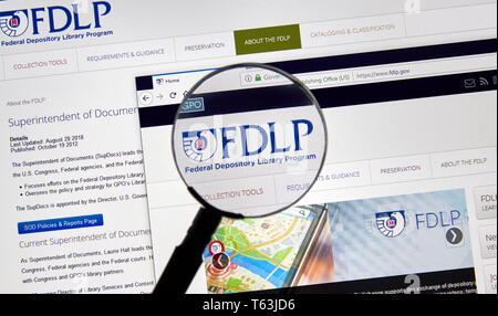MONTREAL, CANADA - APRIL 24, 2019 : FDLP USA Government home page under magnifying glass. Federal Depository Library Program FDLP is a US government p - Stock Image