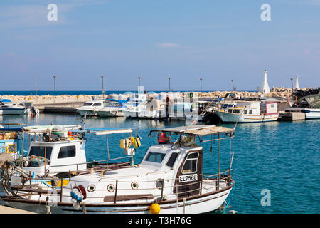 Traditional Cypriot fishing boats moored in Zygi Harbour, Cyprus October 2018 - Stock Image