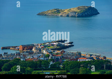 The island of Craigleith and the town of North Berwick, from the summit of North Berwick Law, East Lothian, Scotland, UK - Stock Image