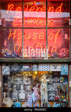 Reverend Zombie's House of Voodoo store window neon sign, voodoo dolls, religious icons, New Orleans French Quarter New Orleans, Louisiana, USA - Stock Image