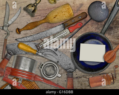 vintage utensils set for cooking over wooden table, blank business card for your text - Stock Image