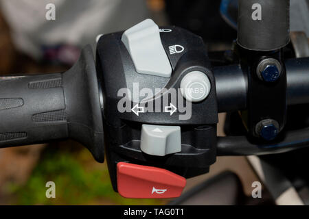 Detail of the controls on the handlebar of a motorcycle. - Stock Image