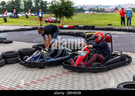 Bielsko-Biala, Poland. 12th Aug, 2017. International automotive trade fairs - MotoShow Bielsko-Biala. Two go-cart drivers preparing to race. Credit: Lukasz Obermann/Alamy Live News - Stock Image