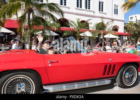 Miami Beach Florida Ocean Drive Art Deco Weekend historic district architecture festival event celebration parade crowd car Co - Stock Image