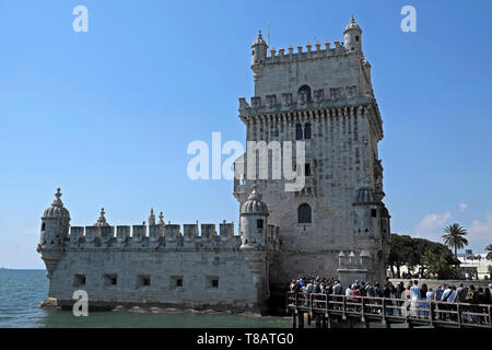Tourists waiting in line on wooden bridge to visit the interior of the World Heritage Site building Belem Tower Lisbon Portugal Europe KATHY DEWITT - Stock Image