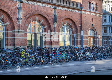 Copenhagen, Denmark - April 30, 2017: Bicycle parking lot with bicycles at the central railway station on a spring sunny morning. - Stock Image