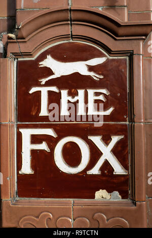 The Fox tiles with tex on the wall outside The Fox traditional English public house on Paul Street in Shoreditch East London EC2A UK  KATHY DEWITT - Stock Image