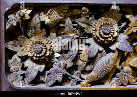Close up of gilded carvings on wooden panels at the back of main hall, Tjong A Fie Mansion, Medan, North Sumatra, Sumatra, Indonesia. - Stock Image