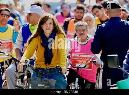 Baghdad, Iraq. 16th Feb, 2019. Iraqis participate in a cycling event in Baghdad, Iraq, on Feb. 16, 2019. After decades of war and conflicts that tarnished the Iraqi streets, Iraqis held a rare cycling event on Saturday, reflecting the revival of life in the once war-torn city. Many women participated in the event for the first time in an attempt to combat sexism and challenge the traditional norms that prevent Iraqi women from riding bicycles in public. Credit: Khalil Dawood/Xinhua/Alamy Live News - Stock Image