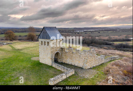 Schladen, Germany, December 11., 2018: Oblique aerial view of the imperial palace Werla with a dramatic sky over the lowland of the Oker - Stock Image