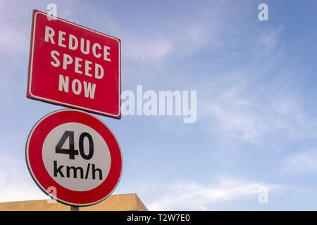 Reduce speed now, 40 KMH, road sign - Stock Image