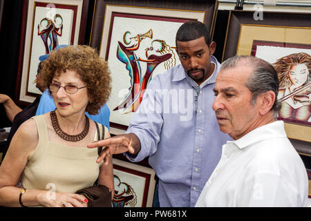 Fort Lauderdale Ft. Florida Las Olas Boulevard Las Olas Art Fair festival artist Aaron Reed Black man men woman couple paintings - Stock Image
