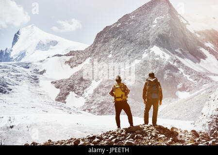 Trekking concept with two friends on mountains background. Spacefor text - Stock Image