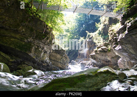 Sun, Bridge, Canyon and Water - Stock Image