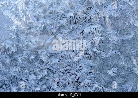 Winter frost pattern  on a glass window pane - Stock Image