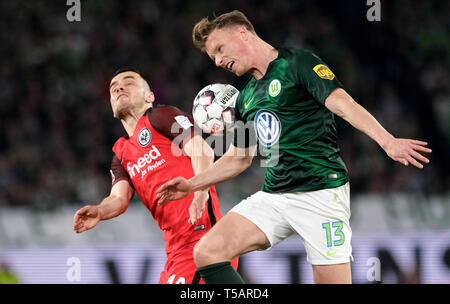 Wolfsburg, Germany. 22nd Apr, 2019. Soccer: Bundesliga, 30th matchday: VfL Wolfsburg - Eintracht Frankfurt in the Volkswagen Arena. Wolfsburg's Yannick Gerhardt (r) and Frankfurt's Filip Kostic fight for the ball. Credit: Peter Steffen/dpa - IMPORTANT NOTE: In accordance with the requirements of the DFL Deutsche Fußball Liga or the DFB Deutscher Fußball-Bund, it is prohibited to use or have used photographs taken in the stadium and/or the match in the form of sequence images and/or video-like photo sequences./dpa/Alamy Live News - Stock Image