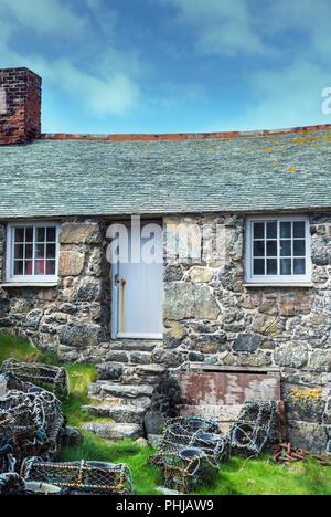 Old fisherman's cottage in Mullion Cove, Cornwall, England, UK - Stock Image