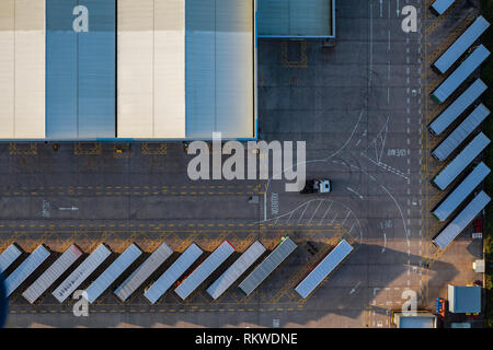 Warehouse and loading bay at sunrise taken from a hot air balloon. - Stock Image