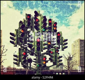 """A grunge effect picture of """"The Traffic Light Tree"""" - an art installation on Trafalgar Way in Canary Wharf, London. Confusion for car drivers - is it stop, go, or get ready? Photo © COLIN HOSKINS. - Stock Image"""
