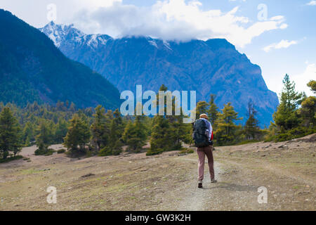 Young Pretty Woman Wearing Red Jacket Backpack Trail Mountains.Asia Mountain Trekking Rocks Path Landscape View - Stock Image