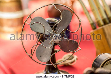 Old fan exposed in a local outdoor flee market - Stock Image