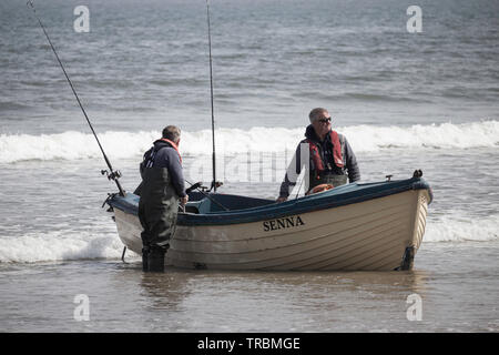 Fishing boat coming in at Saltburn on the North Yorkshire coast. UK - Stock Image