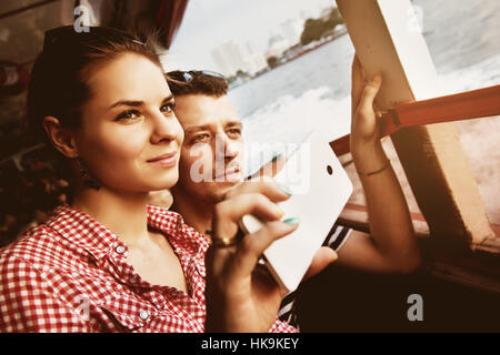 Happy couple travelling boat river - Stock Image