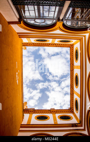 SEVILLE, ANDALUSIA / SPAIN - OCTOBER 13 2017: SKY AND CLOUDS FROM INTERIOR YARD - Stock Image