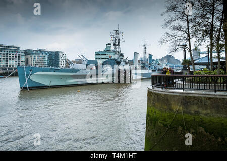 The tourist attraction HMS Belfast moored on the River Thames in London. - Stock Image