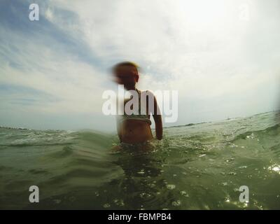 Girl Standing In Water - Stock Image