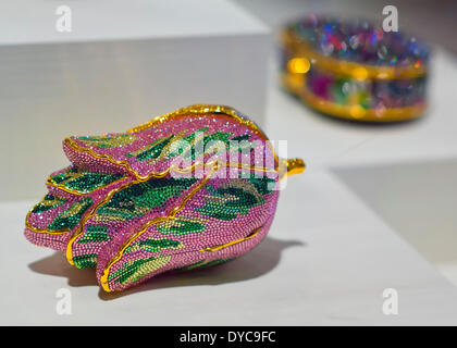 Roslyn, New York, U.S. - April 12, 2014 - A rhinestone Minaudiere collection, including a pink and green tulip bag, is part of the Garden Party exhibit at the Nassau County Museum of Art on Long Island. Credit:  Ann E Parry/Alamy Live News - Stock Image