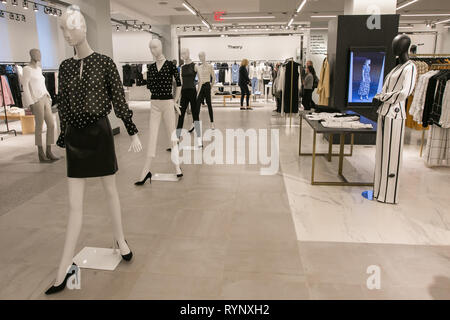 New York, 3/11/2019: Couple of people are shopping at the Theory section of Bloomingdale's department store in Manhattan. - Stock Image