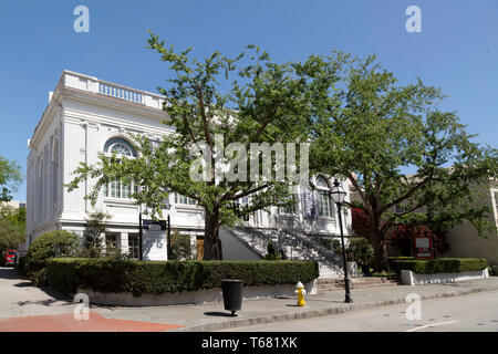 The public library in Charleston in South Carolina, USA. A tree stands outside of the library. - Stock Image