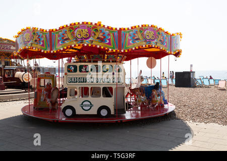 A merry-go-round at Brighton in East Sussex, England. Record Easter temperatures were recorded in England in 2019. - Stock Image