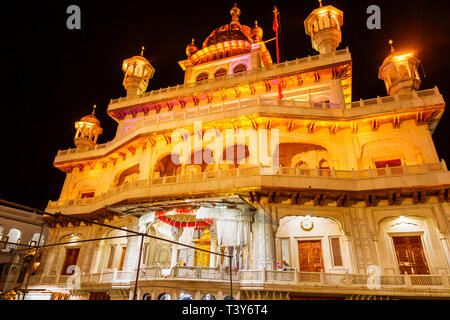 Sri Akal Takhat Sahib in the Golden Temple of Amritsar, the holiest pilgrimage site of Sikhism, Amritsar, Punjab, India, illuminated at night - Stock Image