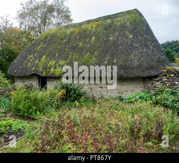 Exterior of a Crofters cottage and kitchen garden  at the Ryedale Folk Museum in Hutton le Hole North Yorkshire England UK - Stock Image