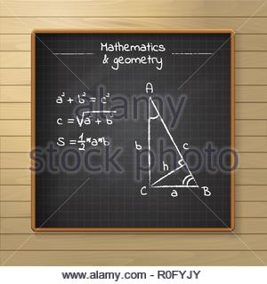 School chalkboard on the wooden background - Stock Image