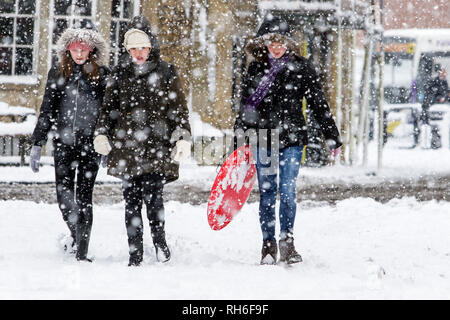 Chippenham, Wiltshire, UK. 1st February, 2019. A group of girls are pictured as they brave heavy snow showers in Chippenham town centre. Credit: Lynchpics/Alamy Live News - Stock Image