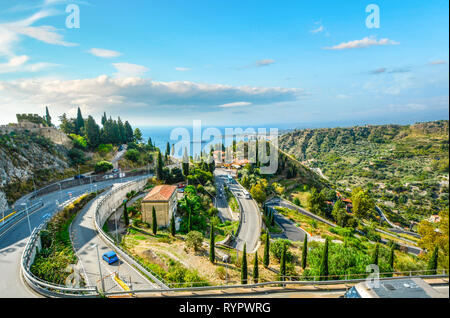 A drive along the Sicilian Coast above the resort town of Taormina Italy on the Mediterranean Sea - Stock Image