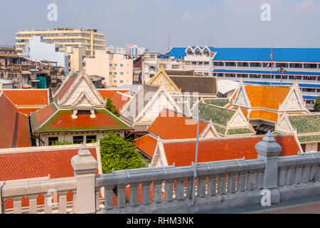 bright orange roof in buddhist temple grounds - Stock Image