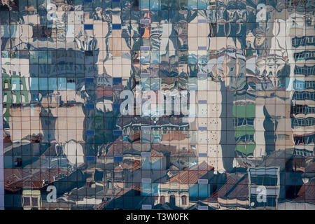 Urban abstraction, reflection of the city on glass building in Rio de Janeiro downtown, Brazil - contrast - ancient houses reflected on modern business edifice. - Stock Image